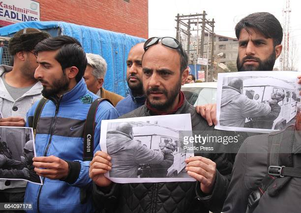 AFP photojournalist Tauseef Mustafa attends a protest in Srinagar the summer capital of Indian controlled Kashmir on March 16 2017 Many...