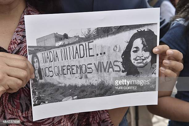 Photojournalists and activists of social organizations protest for the murder of their colleague Ruben Espinosa and four women in Mexico City on...