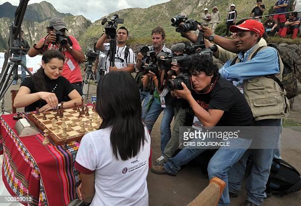Photojournalists and cameramen hound world female chess champion Russian player Alexandra Kosteniuk and Peruvian Under16 world Chess female champion...