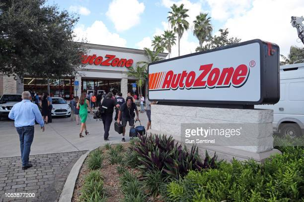 Photojournalists and reporters gather in front of the AutoZone store on State Road 7 in Plantation where Cesar Sayoc Jr of Aventura was arrested on...