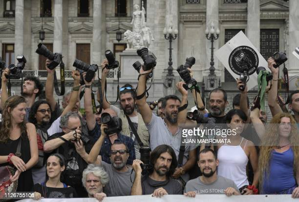 Photojournalists members of ARGRA perform a camarazo in front of the Congress in Buenos Aires on February 22 2019 two days after photojournalists...