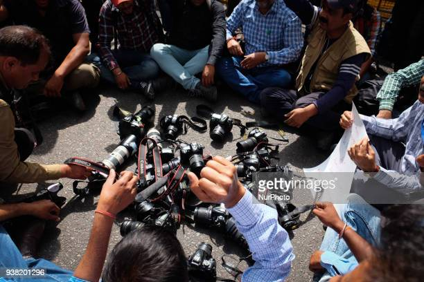 Photojournalists put down their cameras in protest against Delhi Police's recent assault on media in New Delhi on March 26 2018 Members of the press...