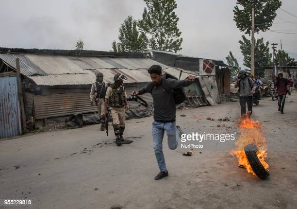 Photojournalists run for cover during clashes between protestors and the government forces Saturday May 5 in Srinagar Indiancontrolled Kashmir Three...