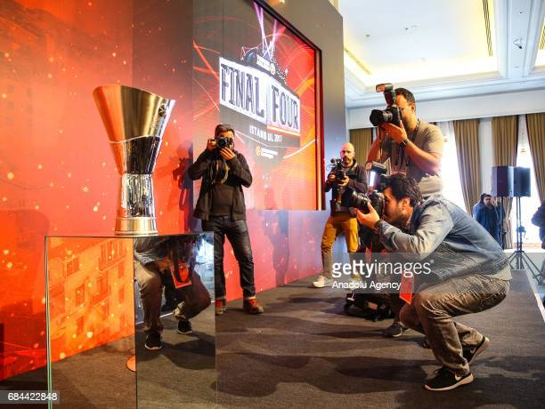 Photojournalists take a photos of trophy during a press conference ahead of 2017 Turkish Airlines EuroLeague Final Four matches in Istanbul Turkey on...