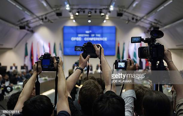 Photojournalists take pictures during the meeting of the Organization of the Petroleum Exporting Countries OPEC at their headquarters in Vienna...