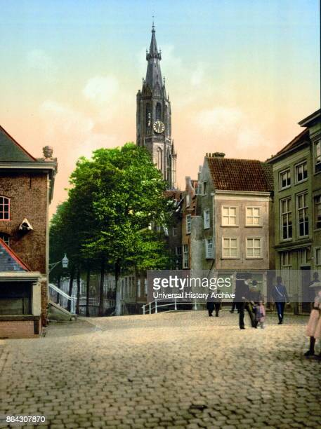 Photomechanical print dated to 1900 depicting the Fish market and new church Delft