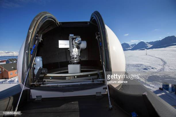 A photometer in the star dome on the roof of the Atmospheric Observatory of the AWIPEV Research Base in NyAlesund on Spitsbergen Norway 09 April 2015...