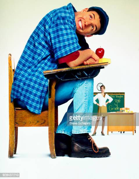 Photomontage of American actor Adam Sandler in costume as the title character in 'Billy Madison' and in the background and also in costume actress...
