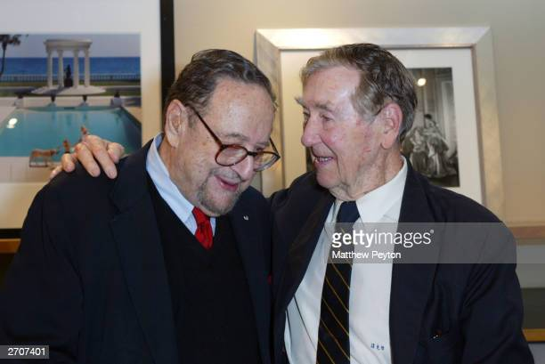 Photoraphers Arnold Newman and Slim Aarons attend the Slim Aarons Exhibition/Book Release Party at the Staley Wise Gallery November 6 2003 in New...