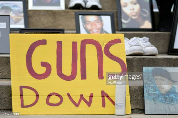 Photos and shoes of gun violence victims following the steps at a antigun rally on the Art Museum steps in Philadelphia PA on June 11 2018 The 3rd...