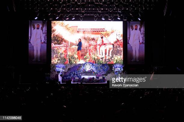 Photos are displayed during Nipsey Hussle's Celebration of Life at STAPLES Center on April 11 2019 in Los Angeles California Nipsey Hussle was shot...