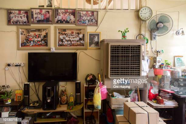 Photos are on display in a house in Air Itam that forms part of the 234 acre land acquired by the 1MDB fund on August 1 2018 in Penang Malaysia...