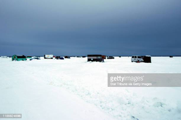 ~ photos by Dennis Anderson for his Outdoors column Sun Feb 8 page C14 about crappie fishing on Upper Red Lake Minnesota Shown here are ice fishing...