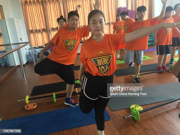 Photos for obesity feature by Alice Yan Chen Chen the girl in the middle is taking physical exercises at a weightlosing camp in Hangzhou 25JUL17...