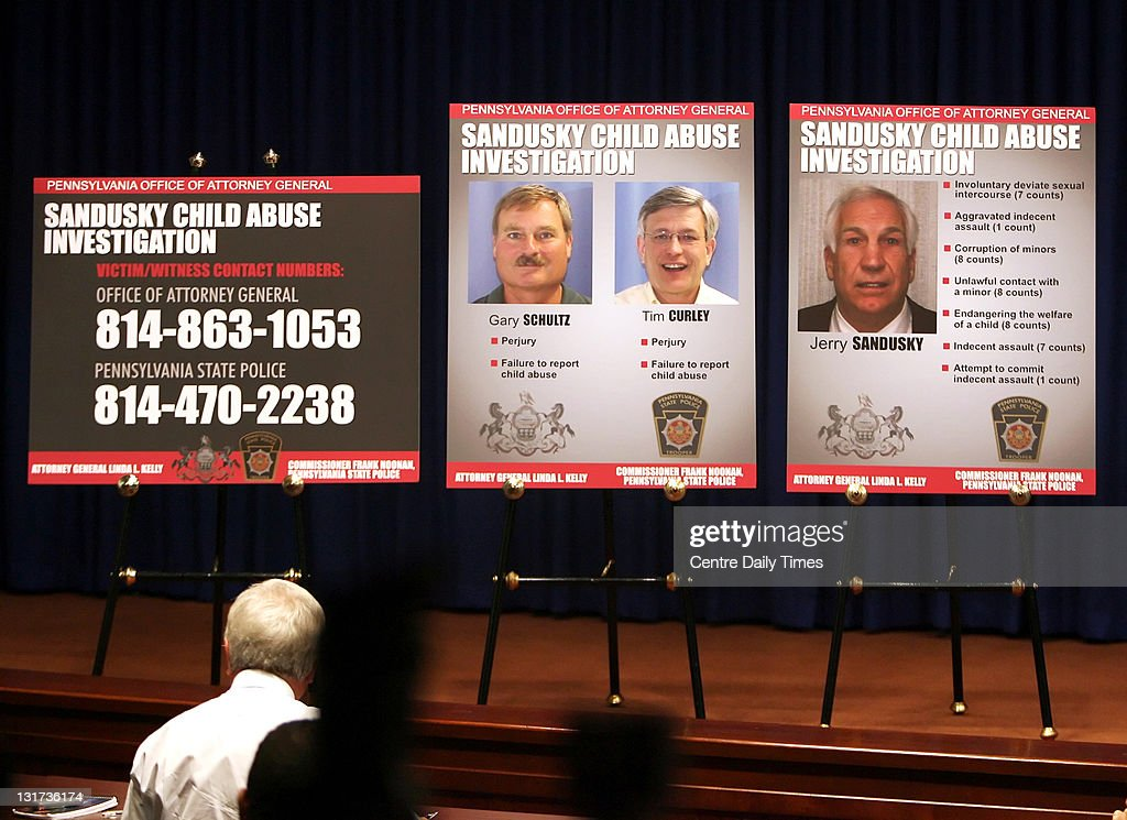Photos, from left to right, of former Penn State vice president Gary Schultz, Penn State athletic director Tim Curley and former Penn State defensive coordinator Jerry Sandusky are seen during a news conference on Monday, November 7, 2011, in Harrisburg, Pennsylvania. Penn State vice president Gary Schultz and Penn State athletic director Tim Curley surrendered on charges that they failed to report suspected child-sexual abuse by a former coach and committed perjury in their related grand jury testimony. The pair is accused of failing to alert police to complaints that former assistant football coach Jerry Sandusky had sexually abused boys. They are also charged with lying to a state grand jury investigating the former defensive coordinator.