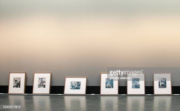 Photos from the exhibition 'Lore Krueger A Suitcase Full of Pictures' lie on the floor at the Amerika Haus of C/OBerlin in BerlinGermany 22 January...