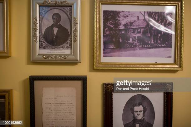 Photos in Beth Miller's entryway of Pedro Tovookan Parris top left Virgil Parris the man who adopted Pedro after prosecuting the slave ship he was...