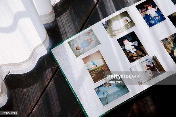 photos of a baby in a photo album