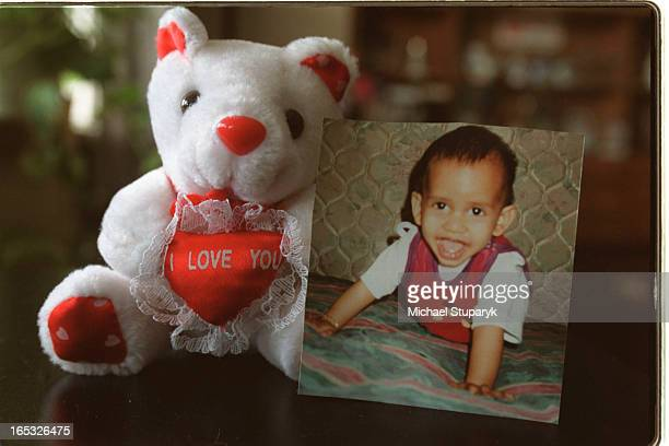 Photos of a little teddy bear that belongs to the older brother Thuluxan7 says I love youplaced next to portrait of the little baby Methusaml8 mos...