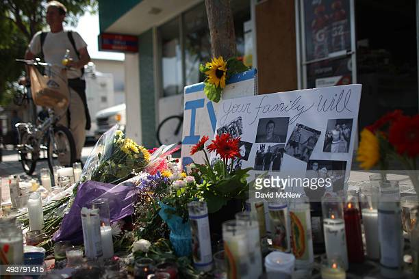 Photos of a victim stand in a makeshift memorial in front of the IV Deli May 25, 2014 in Isla Vista, California. According to reports, 22 year old...