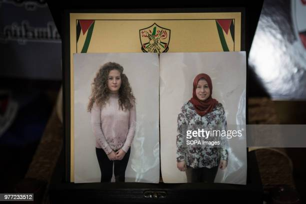 Photos of Ahed Tamimi in her house alongside an image of her mother Ahed Tamimi has been in prison since December 2017 she is a teenage activist in...