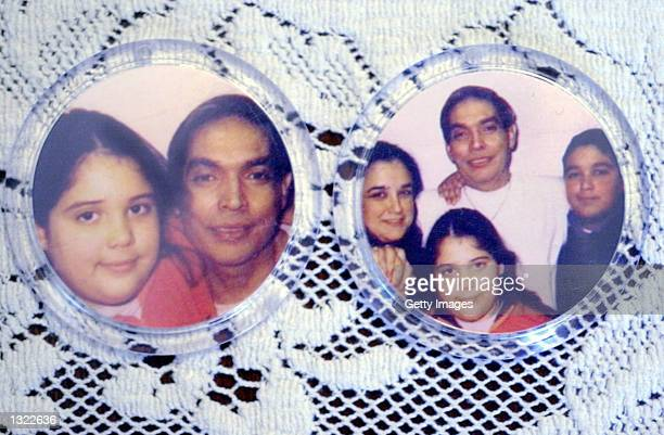 Photos of convicted murderer and drug gang ringleader Juan Raul Garza and his family are on display June 15 2001 at the guest house on the campus of...