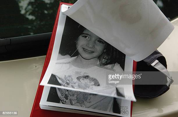 Photos of fouryearold FrenchIsraeli girl Rose are seen in an Israeli police folder during a search for the missing child under a bridge August 25...