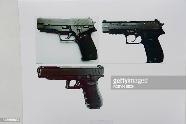 Photos of Glock 34 handguns, similar to the ones used by murder suspect Elliot Rodger are seen at a press conference by the Santa Barbara County...