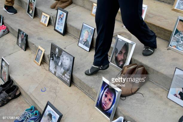 Photos of gun violence victims following the steps at a antigun rally on the Art Museum steps in Philadelphia PA on June 11 2018 The 3rd annual Fill...