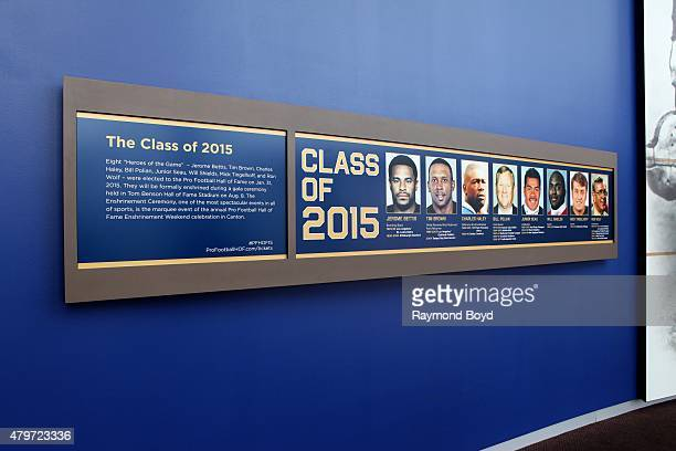 Photos of Hall of Fame Class of 2015 are displayed in the lobby of the Pro Football Hall of Fame on June 20 2015 in Canton Ohio