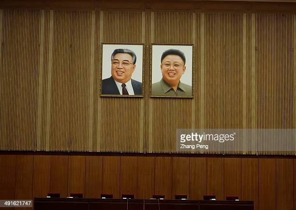 Photos of Kim Il Sung and Kim Jongil are hung on the wall in a meeting hall In North Korea people can see the pictures of their leaders everywhere