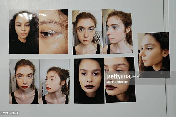 Photos of makeup samples are on display backstage during the Rachel Comey presentation during New York Fashion Week on September 7 2016 in New York...