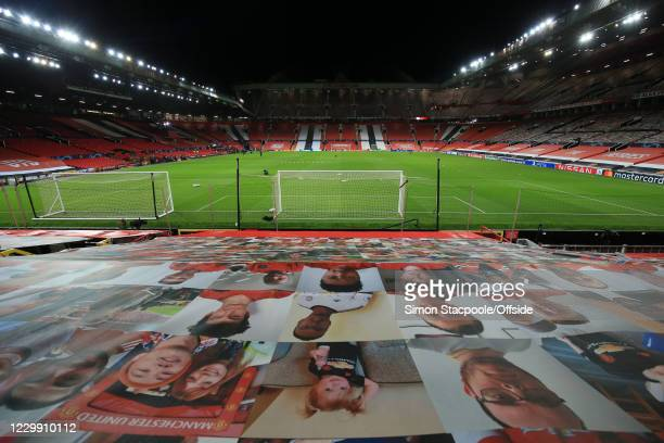 Photos of Manchester United supporters on the empty seats before the UEFA Champions League Group H stage match between Manchester United and Paris...
