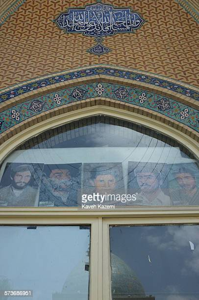Photos of martyrs of Iran-Iraq war are displayed behind the windows of Imam Hussein mosque located on the west corner of Imam Hussein square on May...