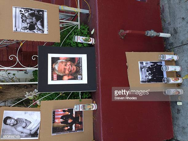 Photos of Nelson Mandela and candles at a memorial still in front of a house on Haight St between Buchanan and Webster two weeks after he died.