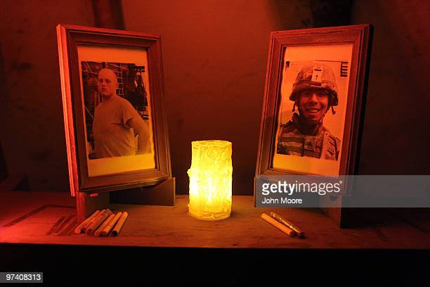 Photos of slain US Army soldiers Sgt Fernando de la Rosa and PFC Christopher Walz are displayed in a memorial chapel on March 3 2010 at Forward...