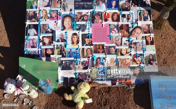 Photos of some of the 58 victims of Sunday night's mass shooting are seen at a makeshift memorial on the south end of the Las Vegas Strip October 6...