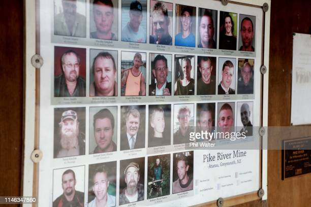 Photos of the 29 deceased miners are shown on display at the public memorial on the access road to the Pike River Mine on May 02 2019 in Greymouth...