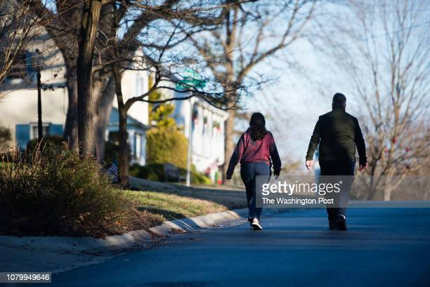 Photos of the Hamlet in Chevy Chase Maryland for a Where We Live feature A couple walks on Glendale Rd near Cypress Pl on a Saturday afternoon The...