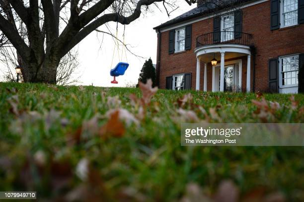 Photos of the Hamlet in Chevy Chase Maryland for a Where We Live feature A swing hangs from a tree branch at the corner of Club Dr and Glendale Rd...