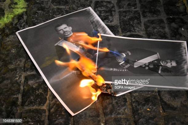 Photos of the king of Spain Felipe VI seen burning during the protest Hundreds of people gather at the Government headquarters of Catalonia hitting...