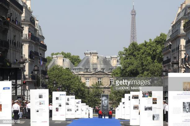 Photos of the late politician and Holocaust survivor Simone Veil are seen on the rue Soufflot leading to the Pantheon in Paris on July 1 2018 ahead...