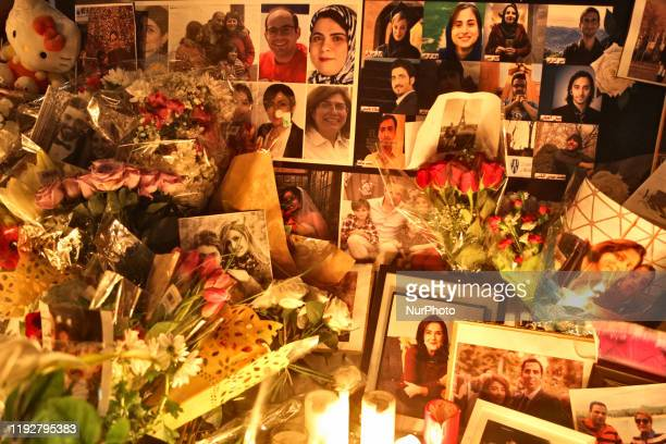 Photos of victims killed during the tragedy as hundreds attended a candlelight vigil at Mel Lastman Square in Toronto Ontario Canada on January 09...