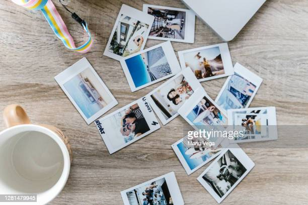 photos on vacation in a table - stock photo - fotostock stock-fotos und bilder