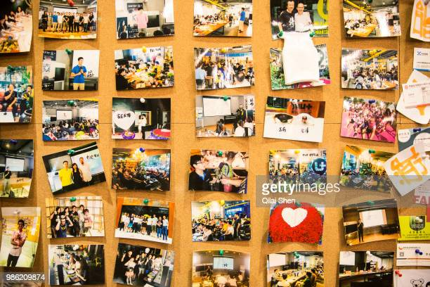 Photos posted on a bulletin board inside a You community in Beijing China on Monday Nov 30 2015 Nearly 5000 people across China have moved into...