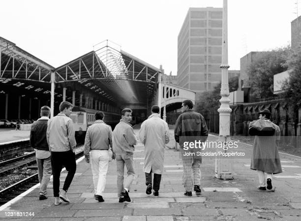"""Photoshoot with the British pop group Madness to publicise their single """" The Ghost Train"""" at Marylebone Station in London, England on 26th..."""