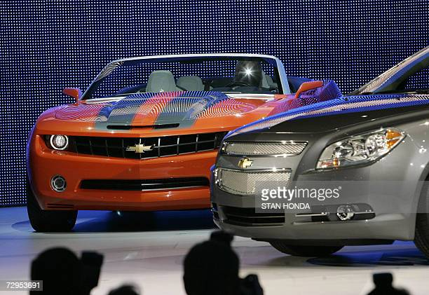 The Chevrolet Camaro convertible concept car is driven onto the stage after the introduction of the 2008 Chevrolet Malibu 09 January 2007 at the...