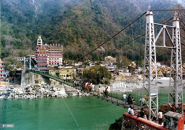 The hanging bridge, Luxman Jhulaover, over the mighty river of Ganges near the historic site of Rishikesh a few kilometres away from the holy city of...