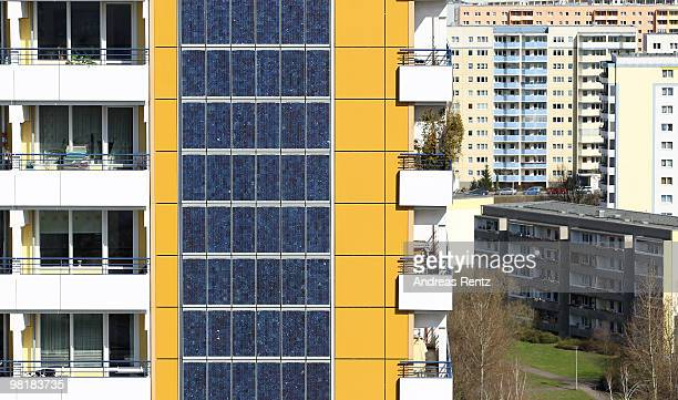 Photovoltaic cells cover the 426 square metre on the 70 m high southern facade of an apartment house stands near concrete 'plattenbau' buildings on...