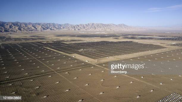 Photovoltaic panels stand at the Golmud Solar Park in this aerial photograph taken on the outskirts of Golmud Qinghai province China on Wednesday...